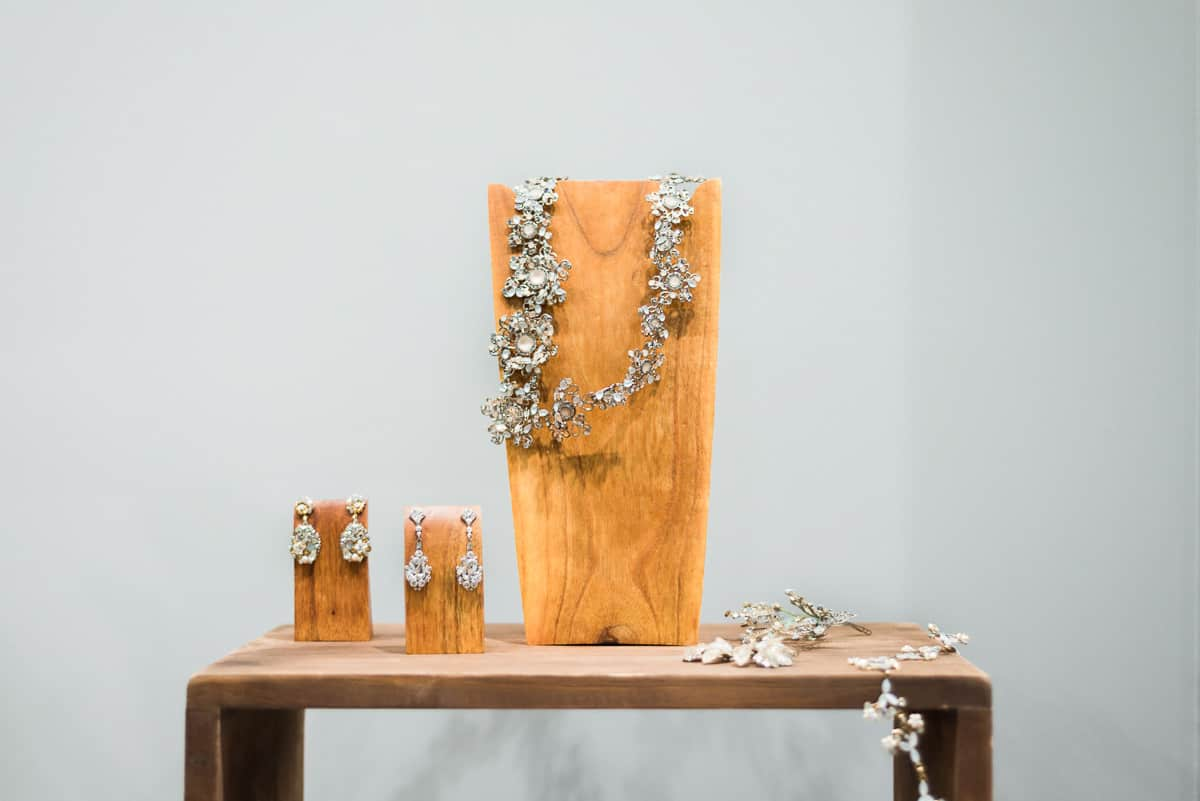 bridal jewelry on wooden display at The Bridal Finery