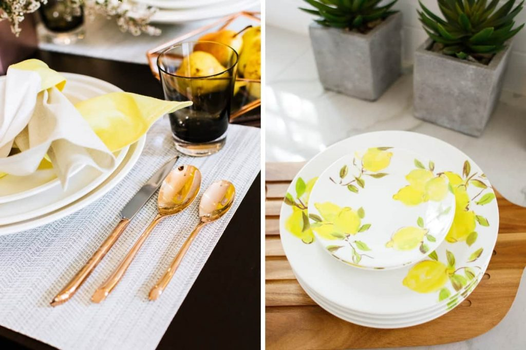 close up of copper flatware and white dinner plates on placemat and stack of white kate spade side plates with lemons