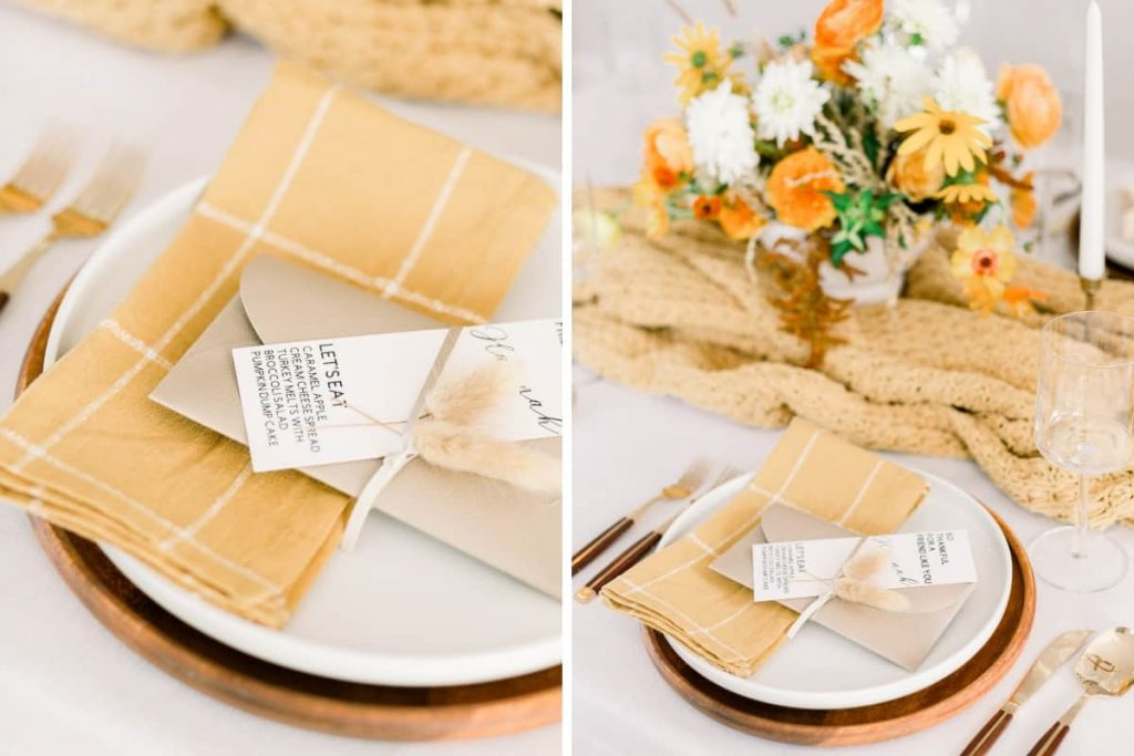 close up of faux leather clutch and dried wheat on white dinner plate and wood charger at fall tablescape