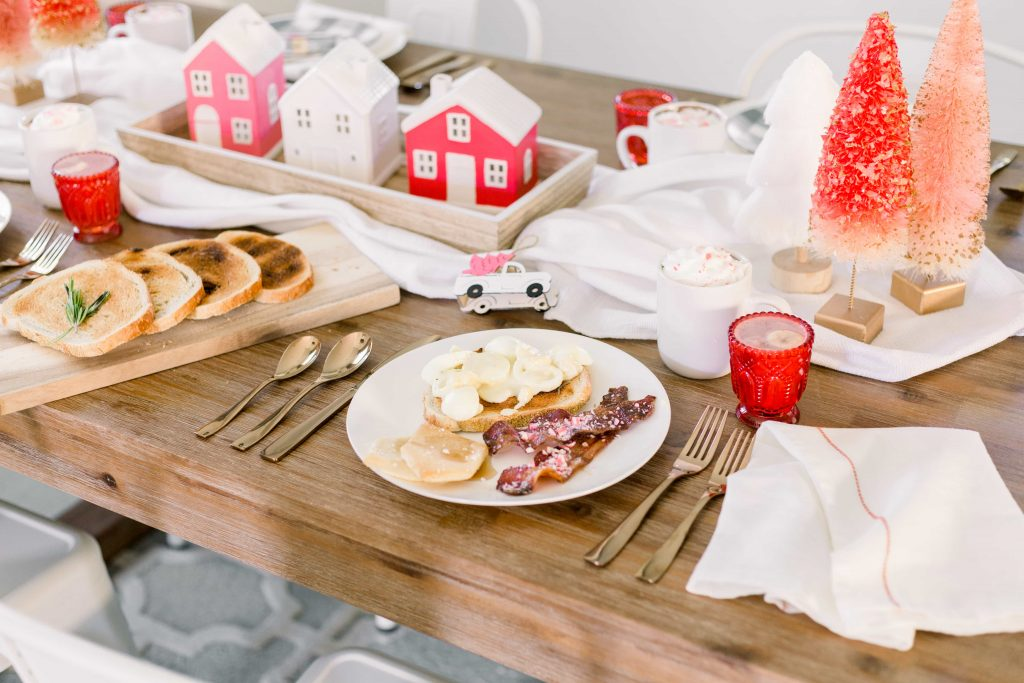 pink white and red christmas themed tablescape with a full christmas brunch