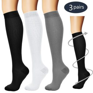 3 pairs of compression socks in black white and grey