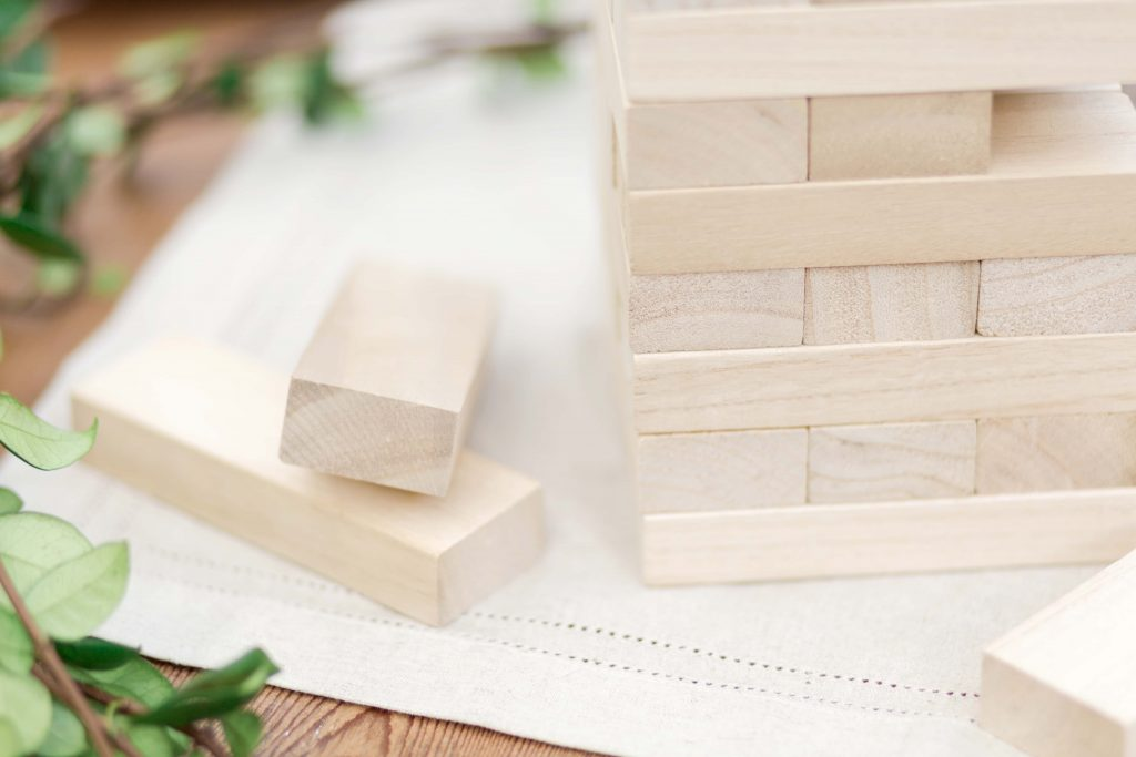 close up of jenga pieces on neutral table runner