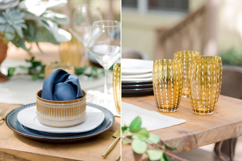 blue and white place setting on outdoor table with burnt orange drinking glasses
