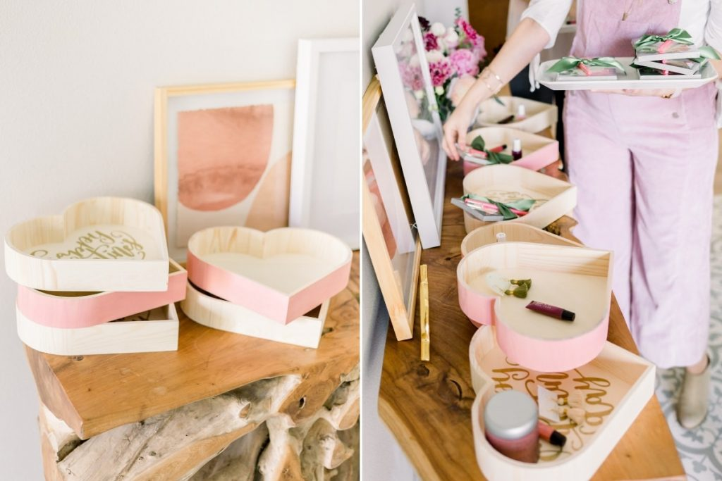 console table with wooden heart boxes full of various beauty products and accessories