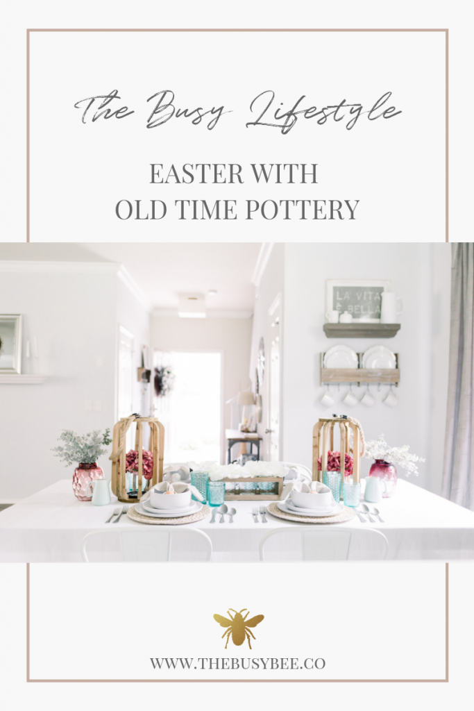 Easter Old Time Pottery white dinnerware with wooden lanterns on top of white linen table cloth