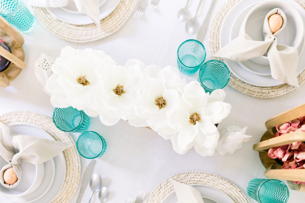 overhead shot of white and teal easter table decor