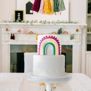 rainbow baby shower cake, tassel banner and decorations
