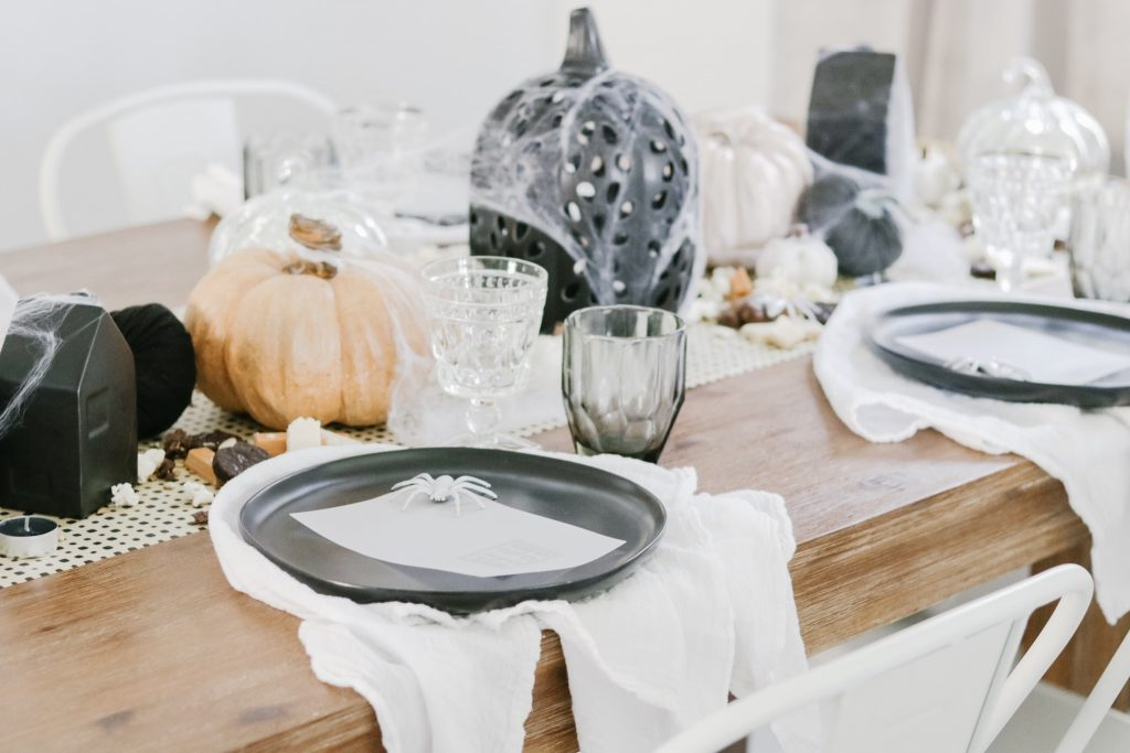 halloween table decor, wood dining room table, white metal chairs, halloween tablescape