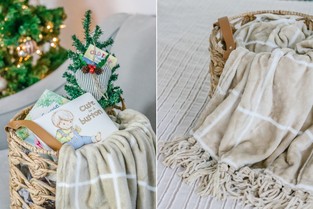 wicker basket filled with tan and white plaid blanket childrens books mini christmas tree and blacka and white heart ornament