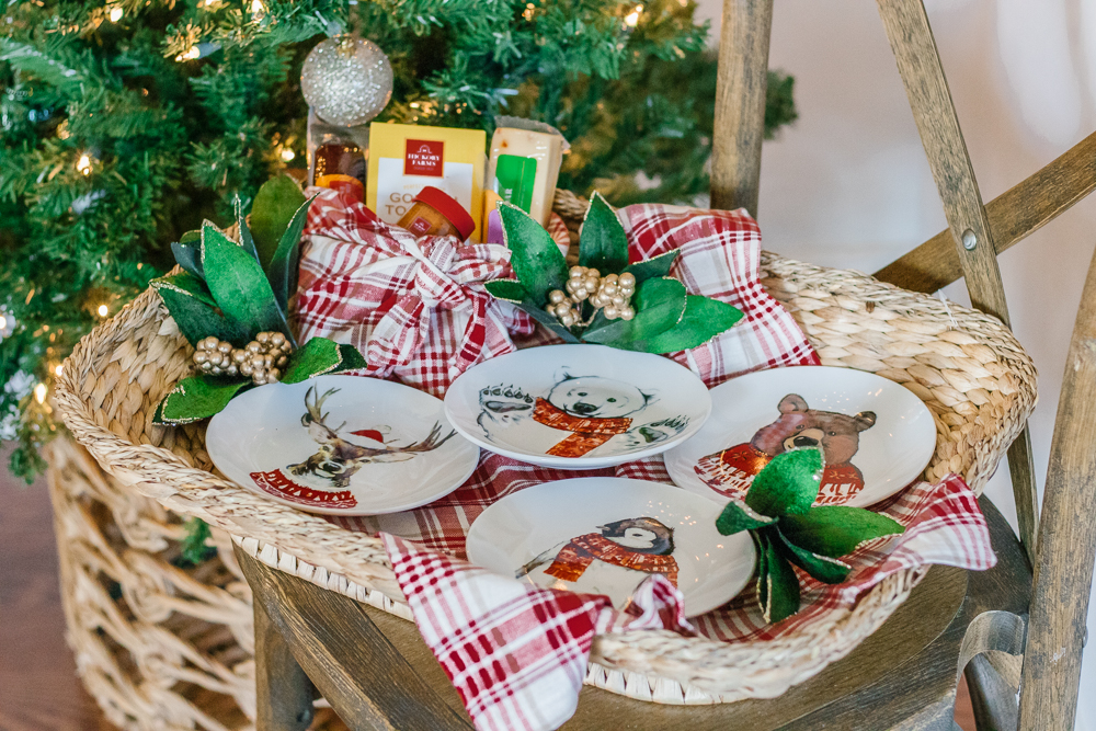 wicker tray filled with hickory farms meat and cheese set and holiday animal print dessert plates