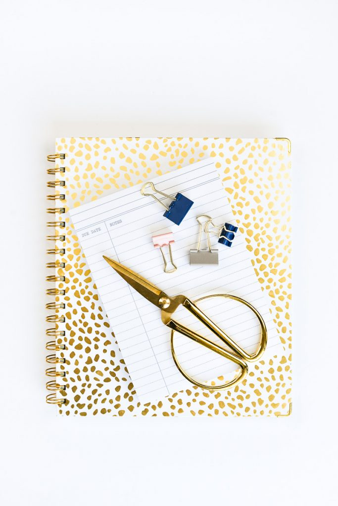 how to start a profitable blog in 2020, canva, the day designer on a desk, gold scissors