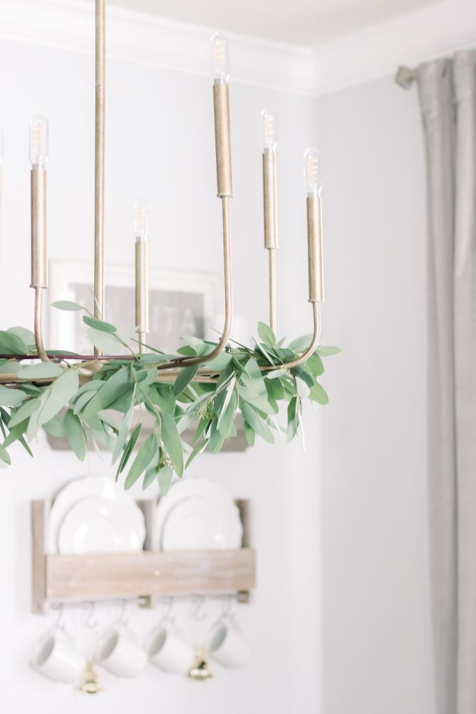 word of the year, gold chandelier with greenery
