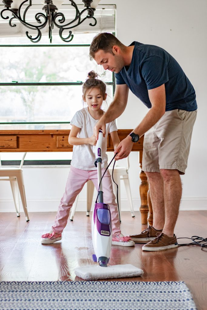 dad moping floor with daughter