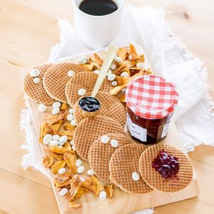 breakfast in bed board with stroopwafels peeled snacks and yogurt covered raisins