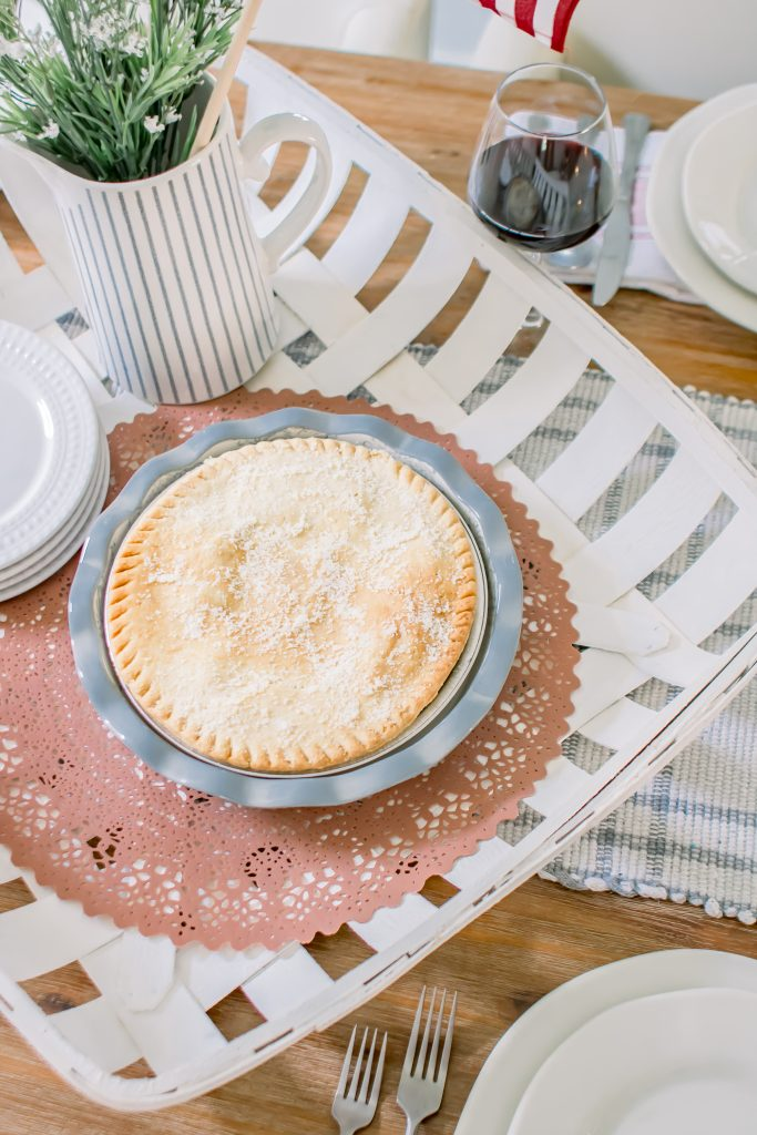 Frozen pot pie in pale blue and off white floral pie dish makes it look homemade