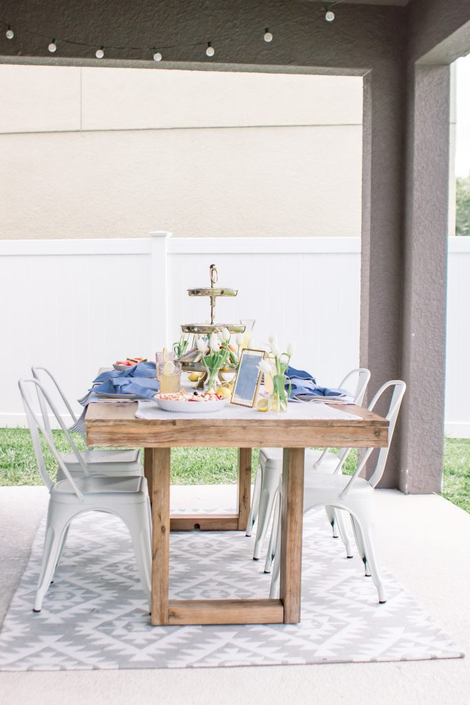 wood dining room table on outside patio for an Intimate Fourth of July Soiree