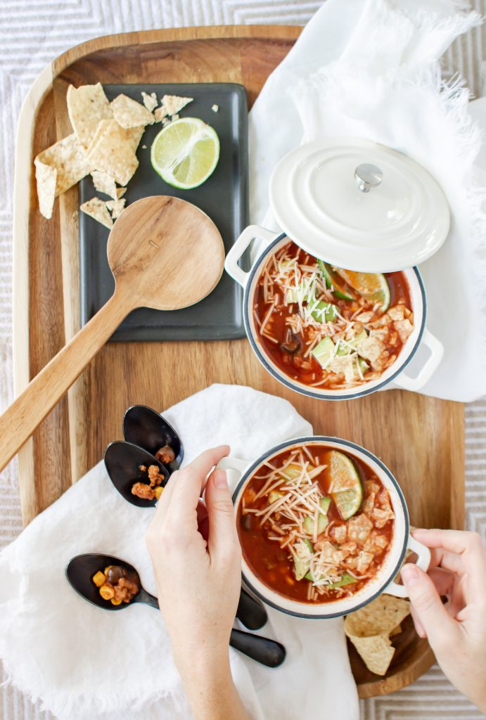 White mini dutch ovens filled with easy taco soup