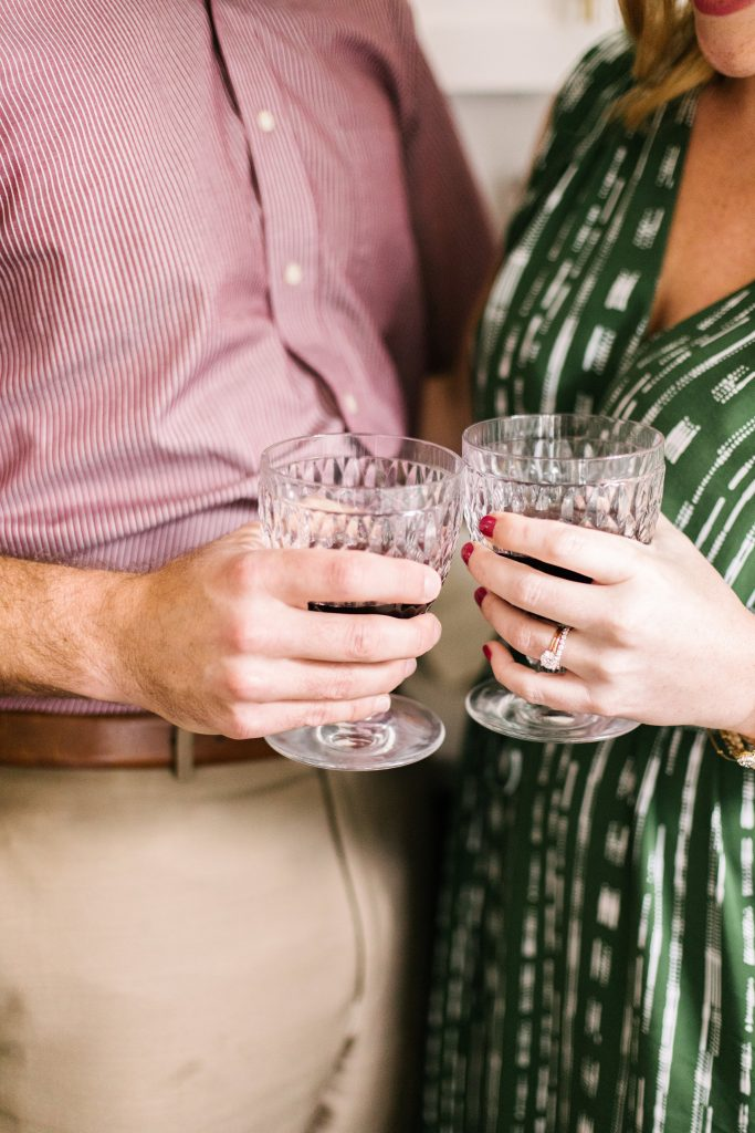 woman and man holding vintage wine glasses
