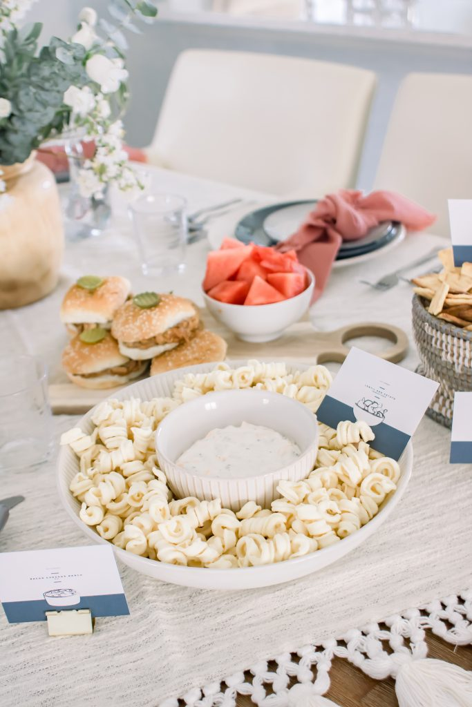 Labor Day tablescape with plates and bowls of Labor Day food ideas