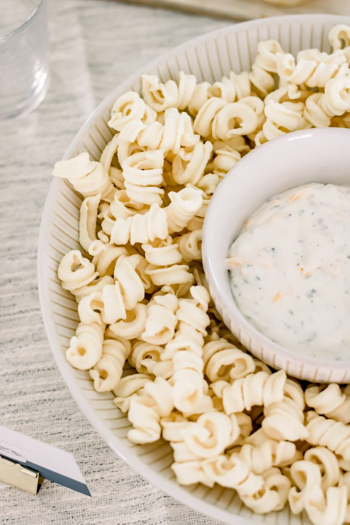 Trader Joe's Lentil Crunchy Curls and Bacon Cheddar Ranch Dip in a creamy white stoneware bowl
