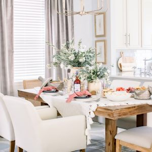 Sophisticated Labor Day tablescape set with floral centerpieces and Labor Day recipes