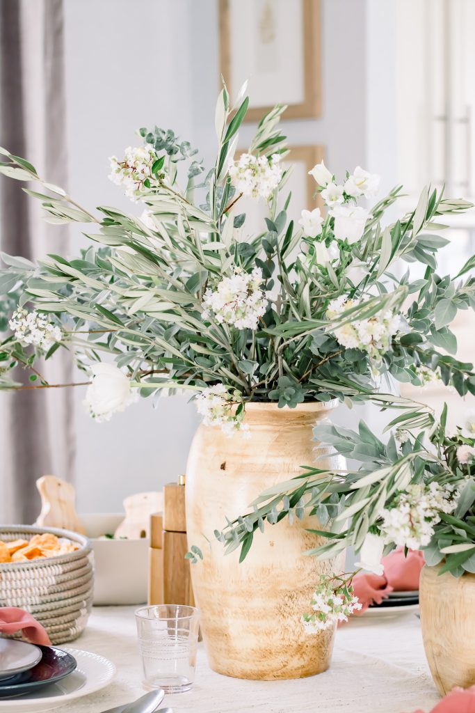 Greenery and white floral centerpiece set on sophisticated Labor Day tablescape