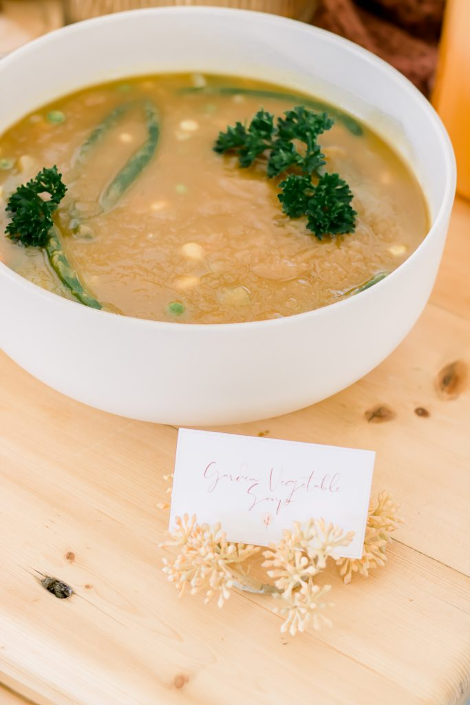 garden vegetable soup in a project 62 bowl on a wooden farm table