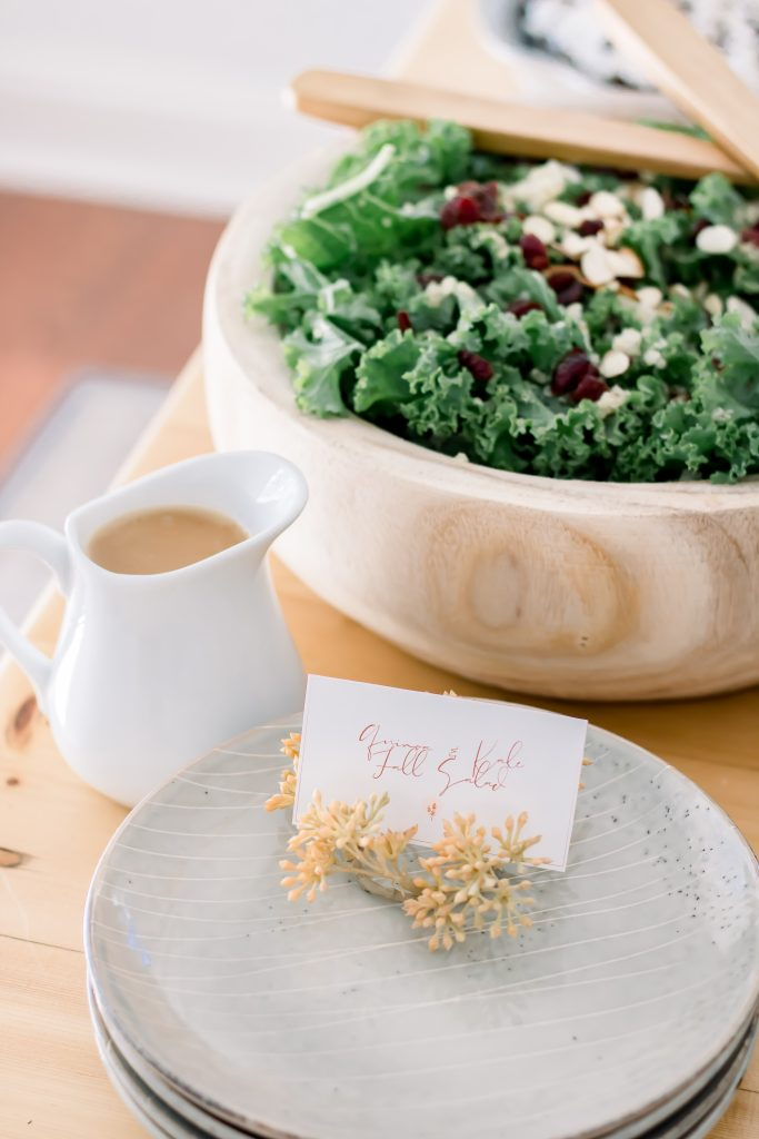 quinoa and kale fall salad inside threshold wooden bowl and project 62 stoneware salad plates