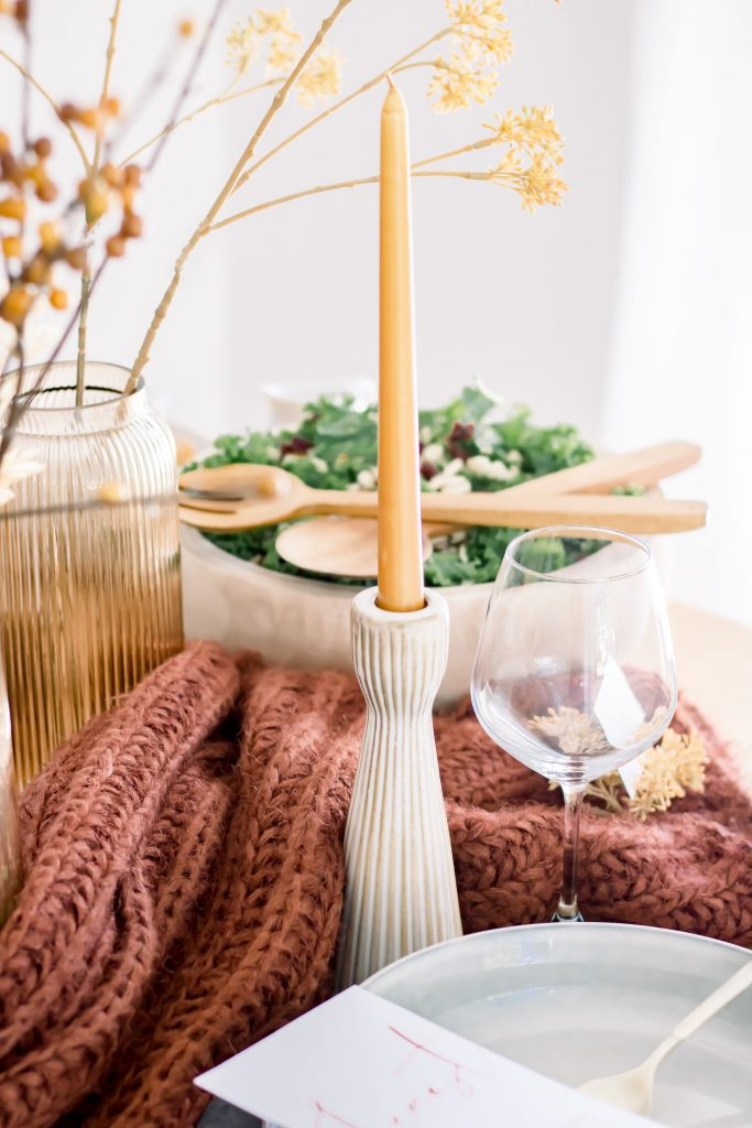Tall cream ridged candlestick holder and gold candle set on intimate Fall tablescape