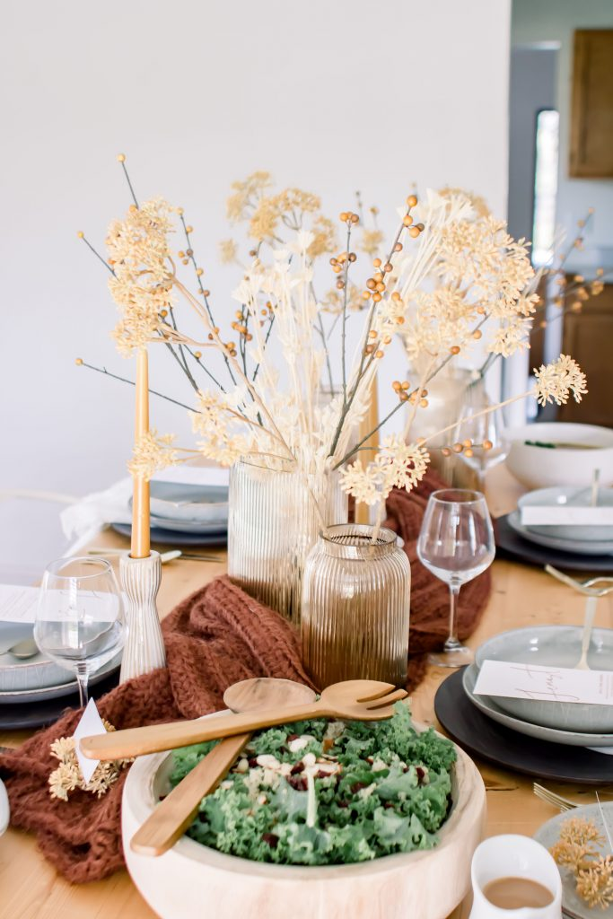 Burgundy mustard and cream Fall tablescape set with glass vases and faux Fall stems
