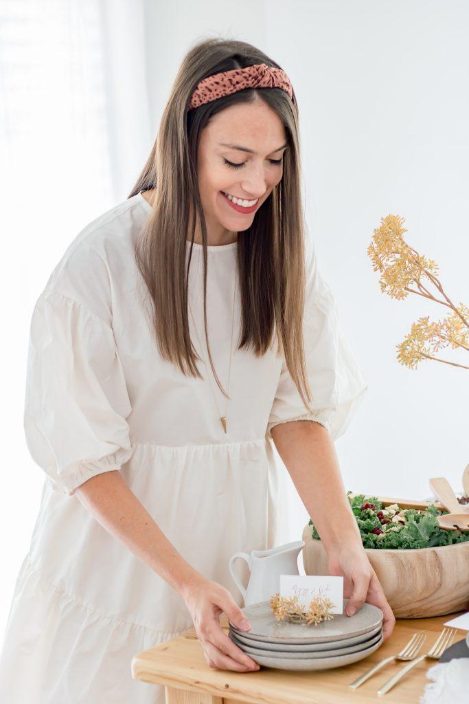 woman holding project 62 salad plates near quinoa and kale fall salad