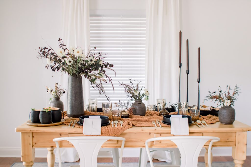 Brown and black Halloween tablescape for a gourmet s'mores pairing party