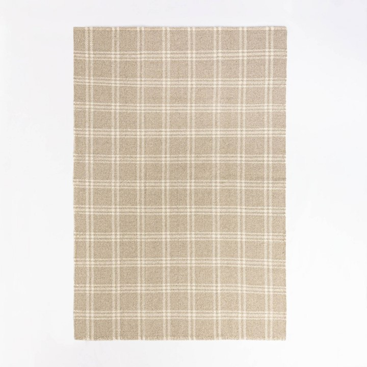 Tan and ivory plaid cotton and wood area rug