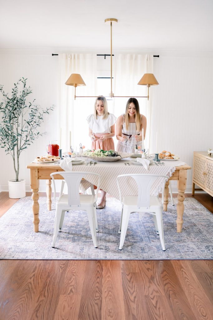 two women setting Easter dining room table