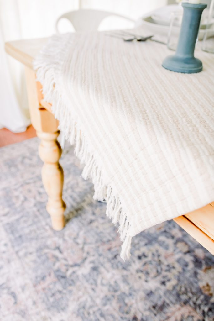 neutral striped throw blanket from Target set on an Easter tablescape