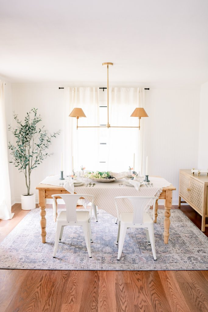 wood dining room table set with an easter tablescape in a transitional dining room