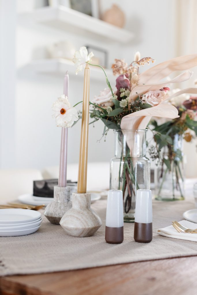 taper candles in marble candle holders