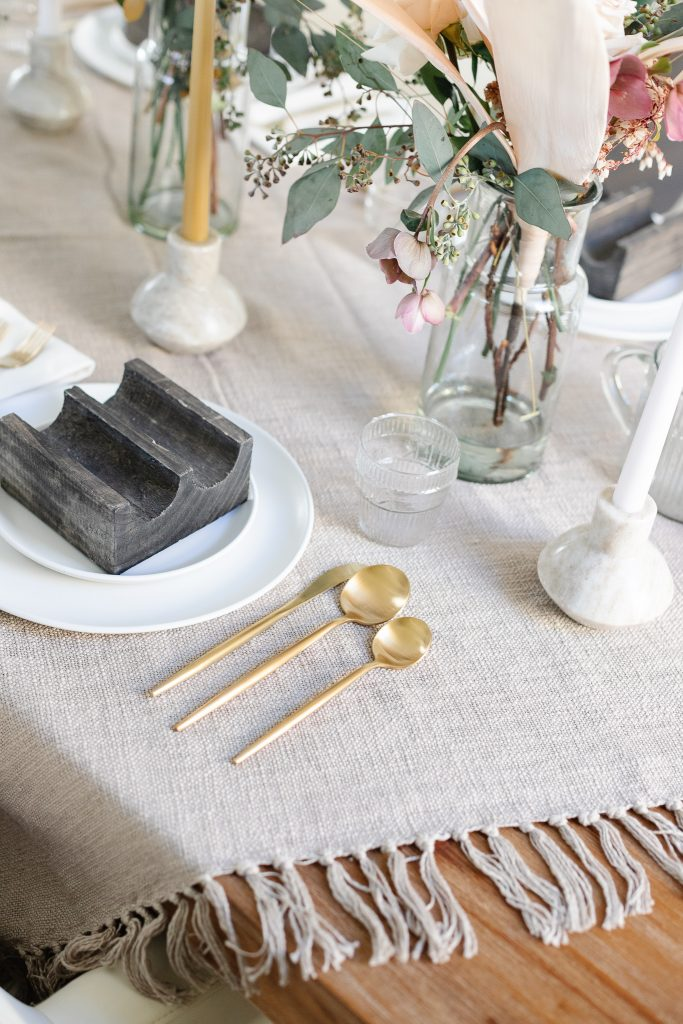 dinnerware and flatware set on dining table