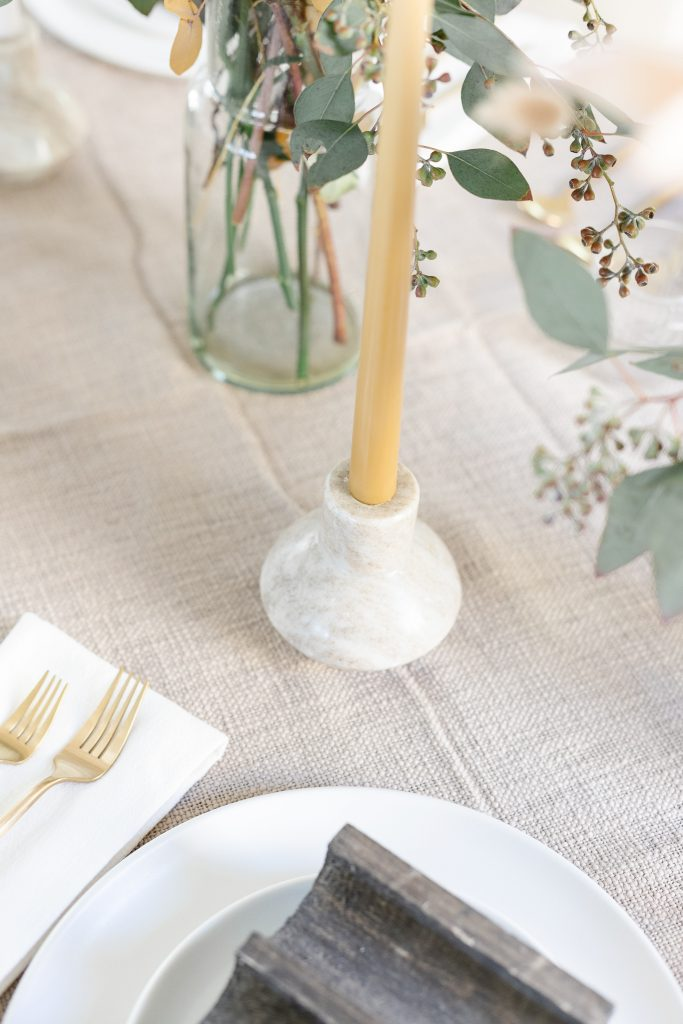 honey candlestick in marble candle holder