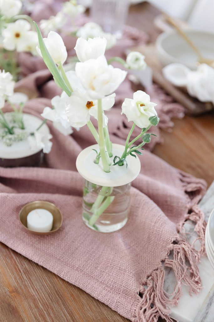 vase of white flowers on dining room table