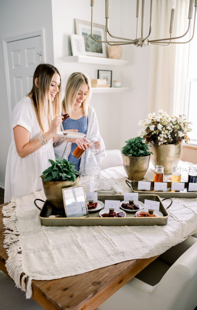two women setting table for Father's Day Jerky & Beer Pairing Party