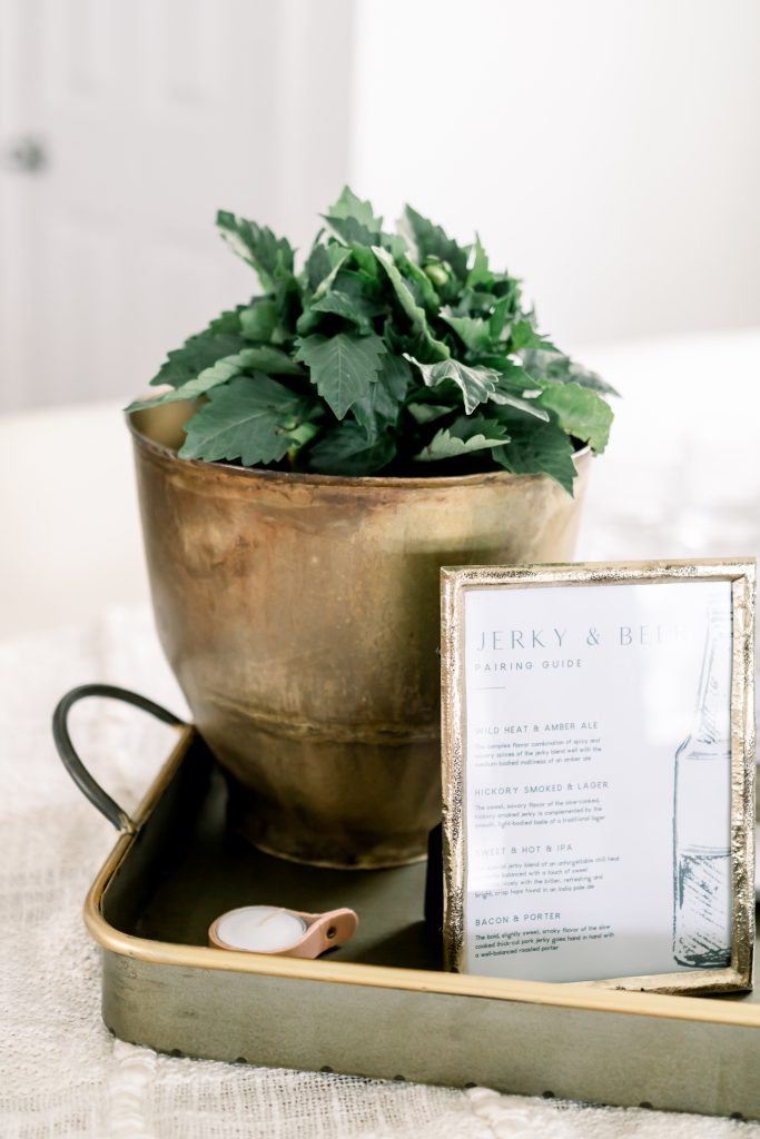 tasting guide in antique brass photo frame with greenery behind