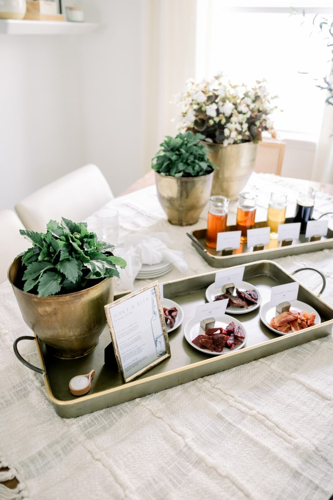 jerky and beer pairing party items on metal trays placed on dining room table