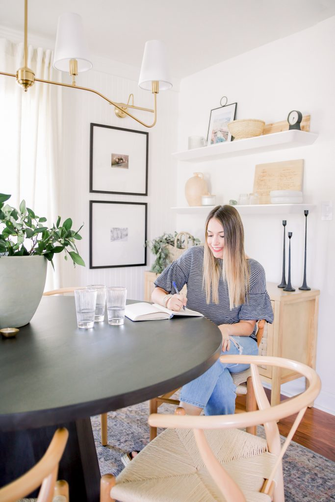 woman sitting in her warm and welcoming dining room