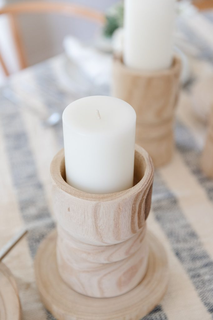 natural wood candle holder and white pillar candle