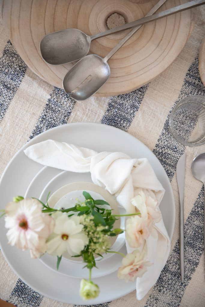 striped blue and white throw blanket with table settings