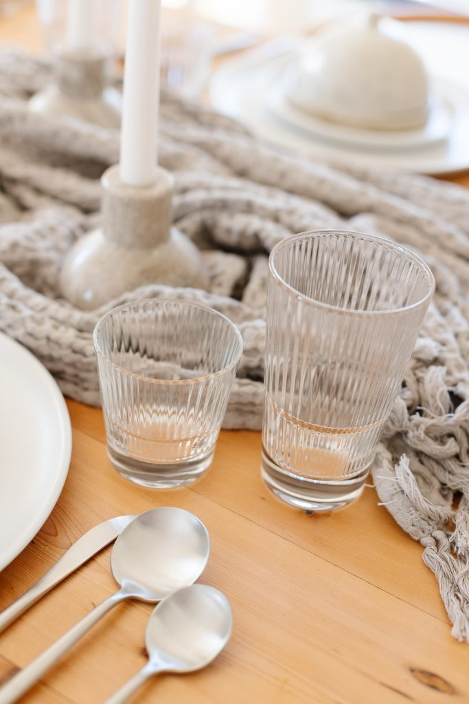 short and tall fluted glassware on dining room table