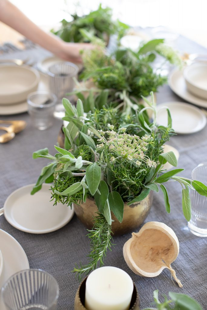 centerpiece medley with candles and greenery
