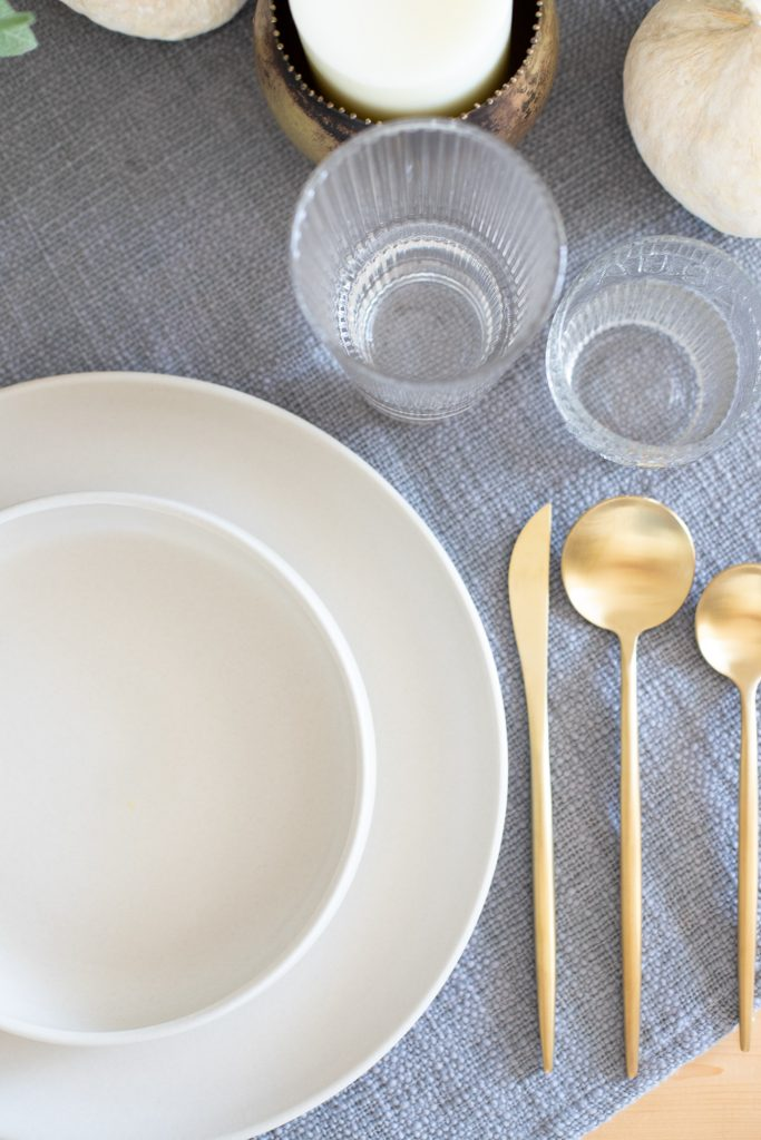 brushed gold flatware with white dinnerware
