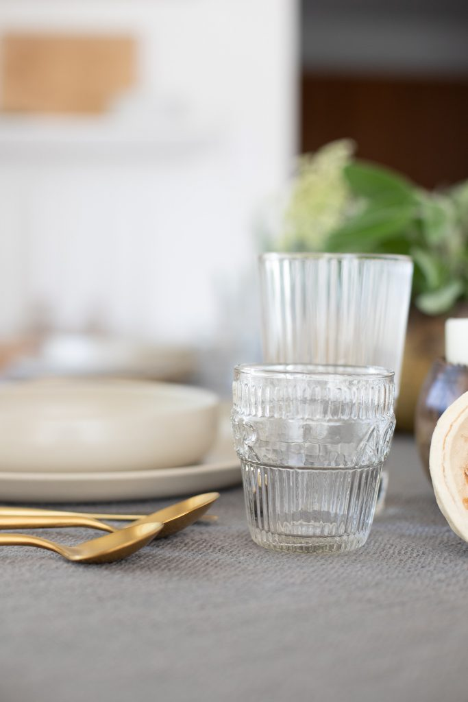 brushed gold flatware with clear glass drinkware